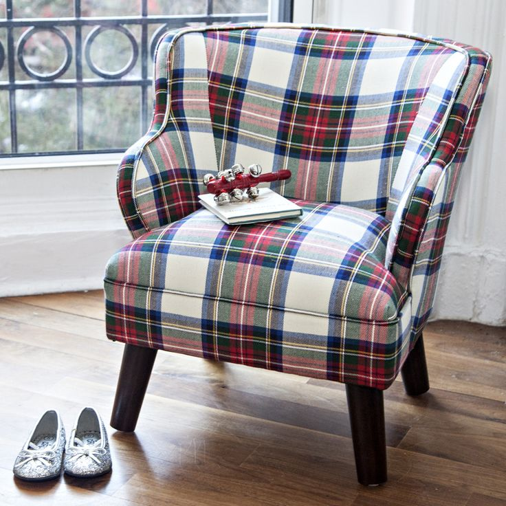 - About - Details - Shipping & Returns A perfect gift, our plaid upholstered…