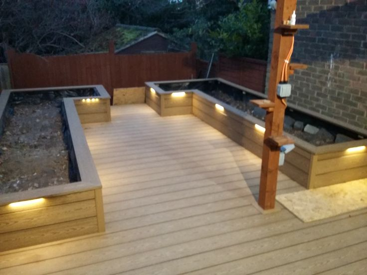 Oak composite Pioneer decking from EnviroBuild, finish off your decking with planters to match.  #compositedecking #decking #balcony #patio #oak #wood