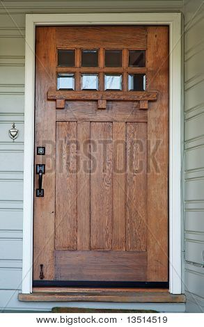 Picture or Photo of Weathered Mission style Wood door with beveled glass windows on California Bungalow