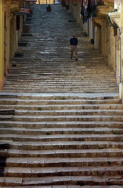 Street of Steps    		St. Ursula Street in Valletta Malta with its daunting flight of steps. They are so ancient! And I have been there many times.