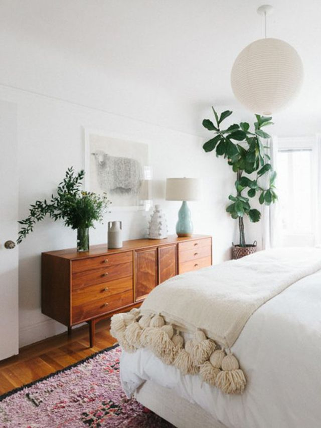 White and Neutral Spaces - cream blanket with tassels on bed and Persian vintage rug add texture. Vintage Mid Century Modern dresser. White fresh, clean beroom