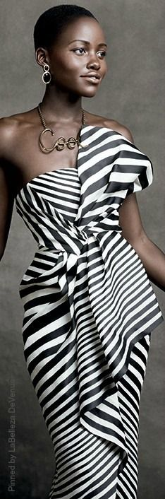 Stunning!  Who can tell me who this #designer is??? #modern  #fashion worn by Lupita Nyong'o