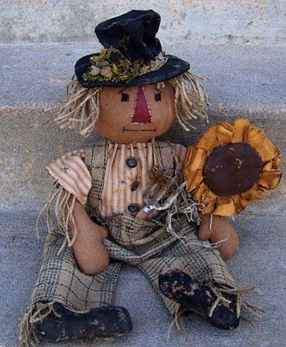 how to make a pumpkin look like a scarecrow
