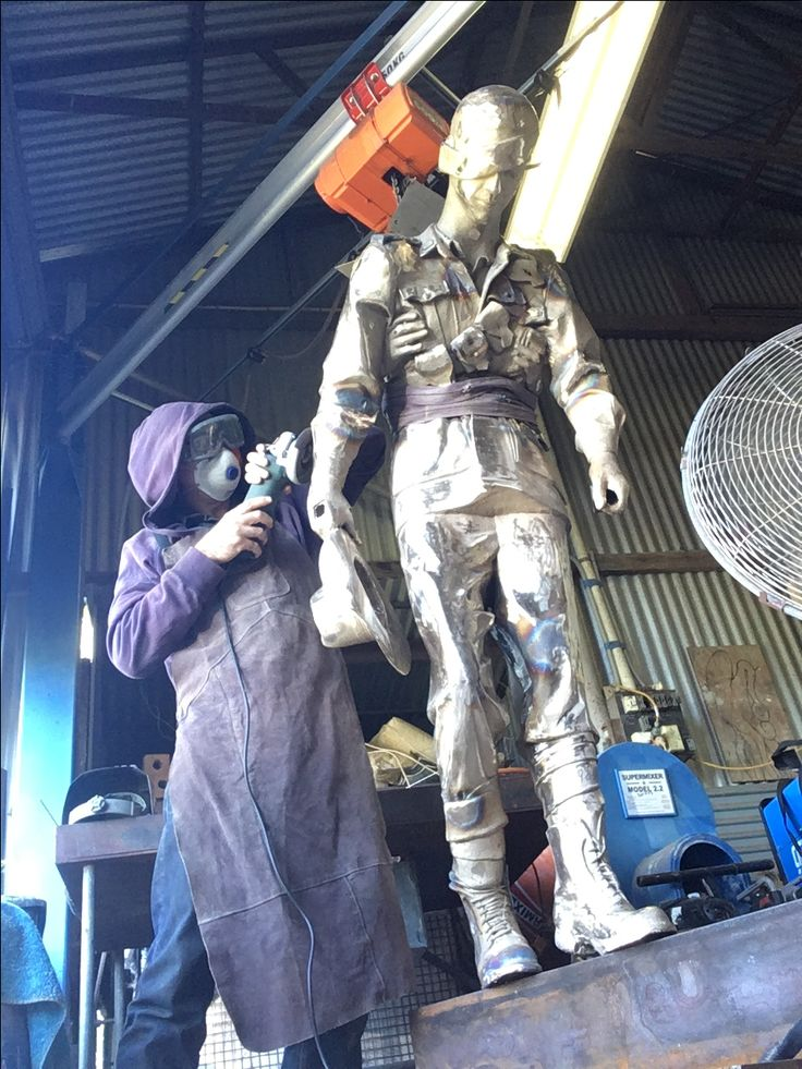 Jody Pawley - Finishing off this life size bronze for sculptor Takis Kozokos