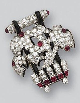 An Art Deco diamond, ruby and enamel brooch, Cartier, circa 1925. The stylised floral motif in Japanese taste decorated with round cabochon rubies and buff-top calibré-cut rubies, completed by numerous small round and single-cut diamonds and enhanced with black enamel, mounted in platinum, signed Cartier. <3