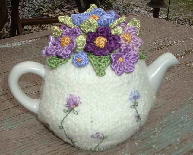 white tea cozy with purple violet flowers