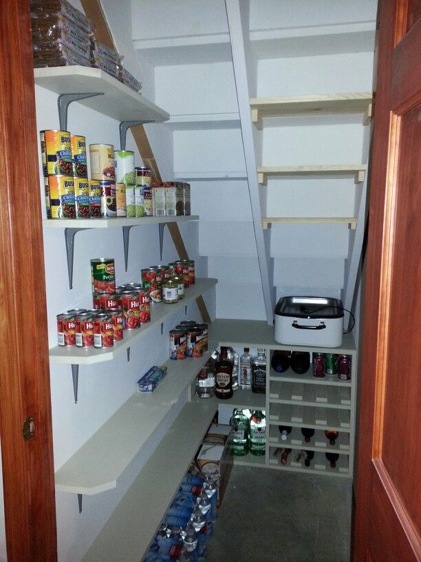 Awesome understairs pantry shelves