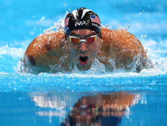 USA TODAY - Michael Phelps wins gold in 200 fly, adds to record medal tally