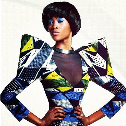 Betty Adewole - unfortunately I don't know the designer - but I love the way the geometric shape of the textiles design has been replicated in the sleeve