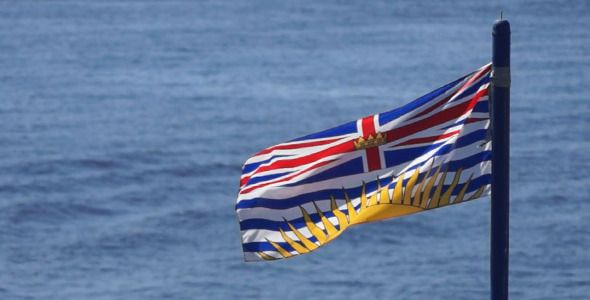 British Columbia Flag On Water by VideoMagus Slow motion close up clip of British Columbia flag windy waving on metal pole of ocean, sea, lake, river transport or shore construction with blurred water waves on the background at sunny morning, day, or evening¡­ Royalty free li