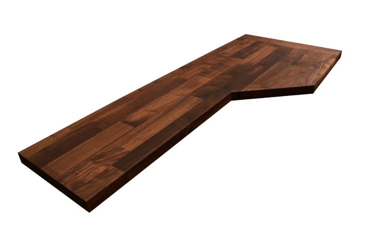 A black American walnut worktop, cut by our fabrication team to accommodate an unusual shaped kitchen, and with an endcap applied: http://www.worktop-express.co.uk/wood_worktops/deluxe-black-american-walnut-worktops.html