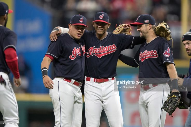 Cleveland Indians third baseman Giovanny Urshela (39), Cleveland Indians infielder Erik Gonzalez (9) and Cleveland Indians outfielder Lonnie Chisenhall (8) celebrate following the Major League Baseball game between the Detroit Tigers and Cleveland Indians on September 11, 2017, at Progressive Field in Cleveland, OH. Cleveland defeated Detroit 11-0.