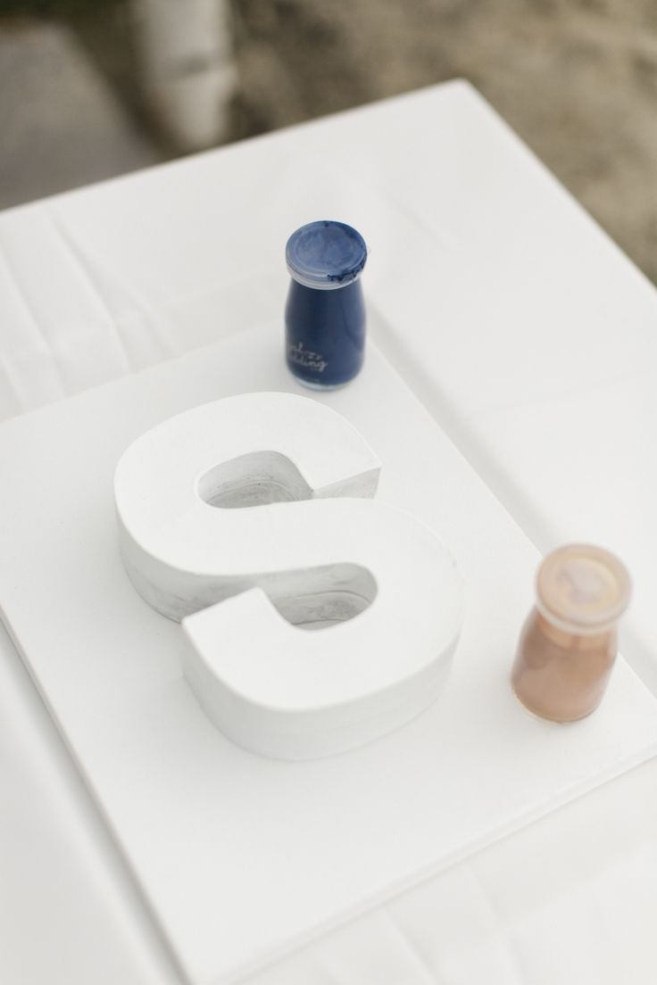 Instead of a traditional Chinese tea ceremony, Priscilla and Daniel opted for a custom unity paint ceremony during their wedding. Together, they poured rose gold and navy paint over a white S, representing his last initial. (The tea ceremony came later at their second reception, in Hong Kong.)
