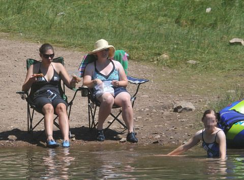 Click on the picture. Jaycee Dugard, right, at Sly Park, with a recovered childhood friend, and one of Jaycee's daughters (in the water).