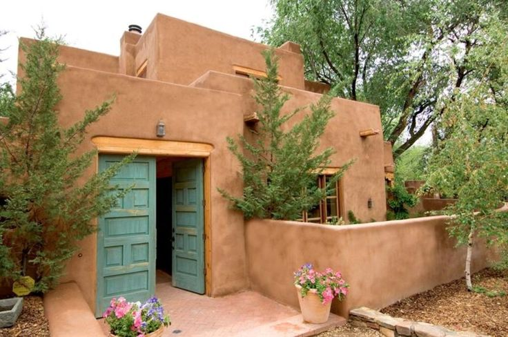 The home sits under 200 year old cottonwood trees in a