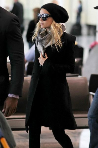 #NicoleRichie looking cozy in this simple black coat and scarf, paired with sunglasses and a beanie.  Shop #DMLooks at DivaMall.tv
