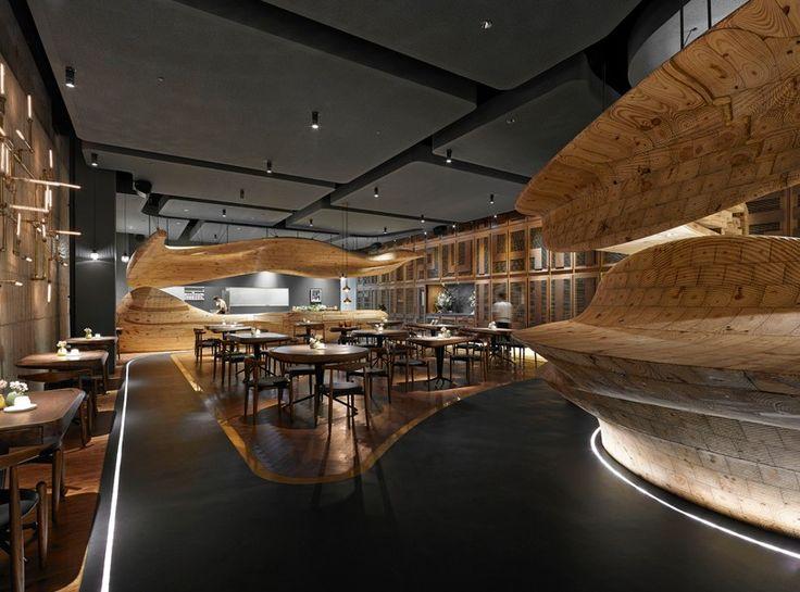 weijenberg weaves sculpted timber element around RAW restaurant in taipei
