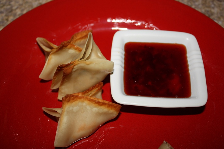 ***Asian chicken Wontons***  Dice cooked chicken (I used left over baked chicken).  Cream one pkg cream cheese with mixer.  Add diced green onion, garlic, soy sauce, ginger and mix.  Stir in diced water chestnuts and diced chicken.  Place a tsp - a Tbsp on each wonton wrapper.  Brush edges with melted butter and fold edges together.  Brush outside with melted butter and bake at 350 for 10 minutes.  Sauce*** Place several Tbsps of Hot Pepper Jelly (Reece is the brand I use, found on the Asian…