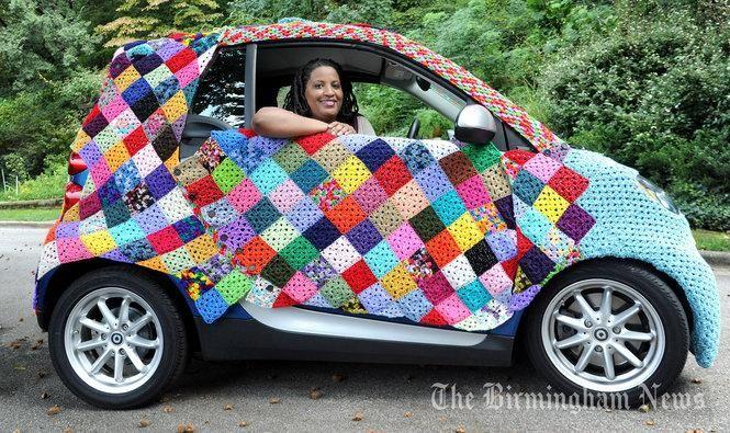 A yarn-bombed smart car