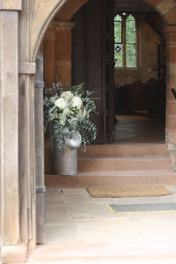 Make a statement with Church Wedding Flowers in milk churns www.passionforflowers.net
