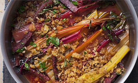 Braised chard with crumbs baked in a round pot with handles