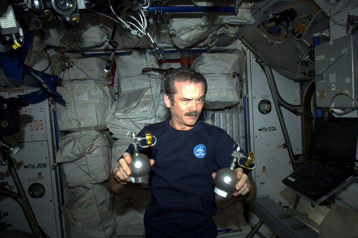 "Canadian astronaut Chris Hadfield holds up two objects that look like grenades as part of an April Fools' Day prank. (Credit: Canadian Space Agency/Chris Hadfield ) April 1, 2013. ( They're actual air sampling devices.) Mona Evans, ""Astronomy April Fools"" http://www.bellaonline.com/articles/art183019.aspAstronaut Chris, Agency'S Chri Hadfield, April Fools Day, Canadian Spaces, Chris Hadfield, Canadian Astronaut, Air Samples, Astronomy April, Spaces Agency'S Chri"