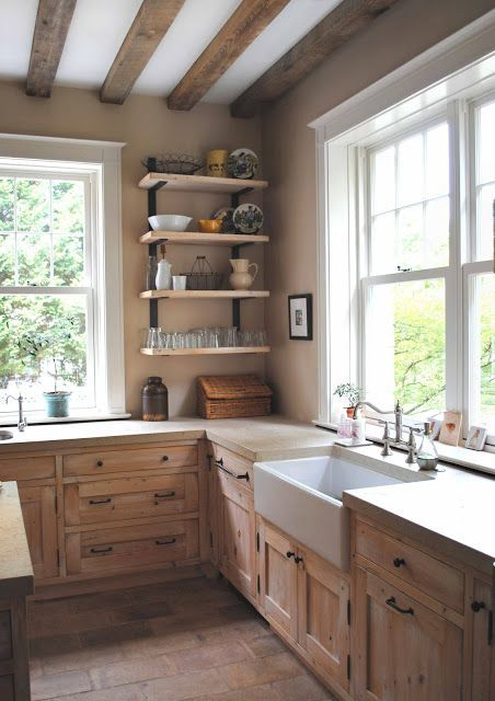 Look at this rustic kitchen with the farmhouse sink-wood cabinets-lots of light and really simple-no upper cabinets just a few open shelves-really like it how bout you?