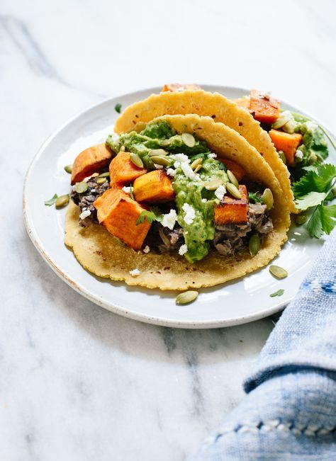 These roasted sweet potato tacos feature spicy black beans and avocado-pepita dip. Delicious! This taco recipe is vegetarian (easily vegan) and gluten-free. http://cookieandkate.com