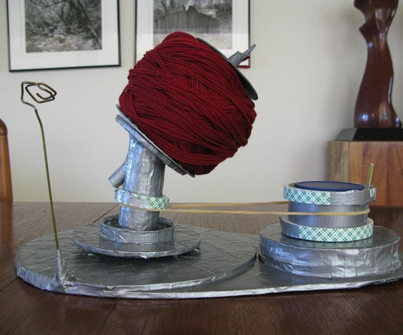 I have been looking for a ball winder to wind center-pull balls of yarn. After reading many reviews of commercially made winders, it seems that all of them have something wrong with them. So I decided to make my own. It is not perfect, but I made it all by myself! This Ball Winder can wind 100 grams of yarn easily, and I was able to double up and wind two 100 gram balls together as well!! This instructable may look long, but you could make it in a few hours.   I didn't feel like working ...
