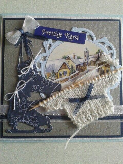 Kerstkaart met schaatsen van marianne design mal. Gebreid truitje en lint met strikjes.