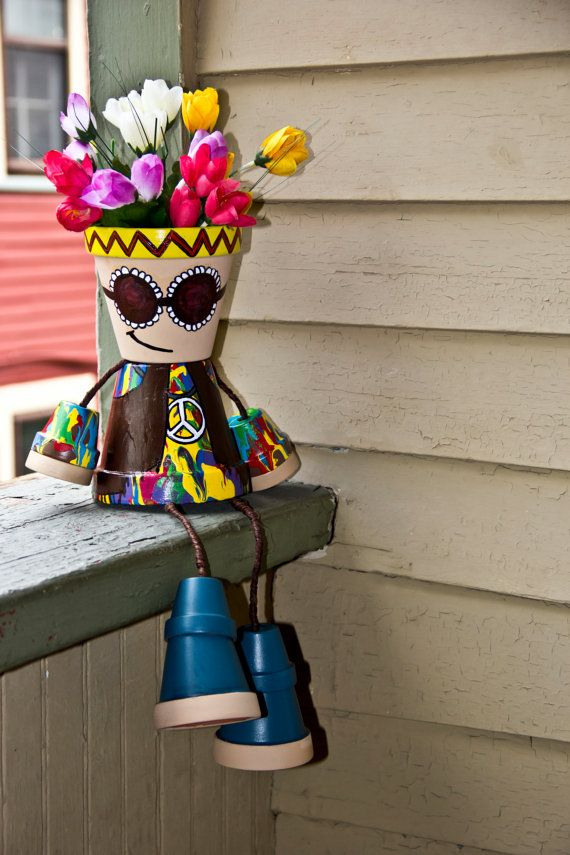 Hand painted Hippie flower pot person, Paisley design.  This cute flower pot person is great for decorating any garden, outdoor living space or even