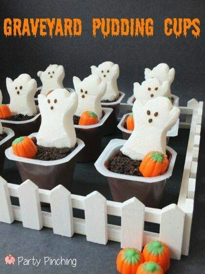 Graveyard Pudding Cups for Halloween - crushed oreo cookies, Ghost Peep and a candy pumpkin. Can also put the ghost and pumpkin on top of a chocolate cupcake.