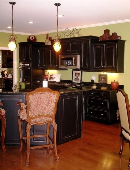 Oooh...I want black or cream distressed kitchen cabinets SOOO bad...I was leaning toward cream but this is changing my mind!! Love it!