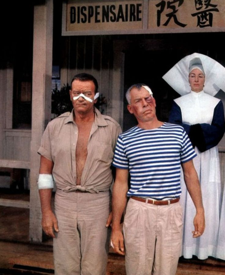 Donovan's Reef (1963) In a fight with Lee Marvin, John Wayne underestimated an uppercut. He crashed through a table and fell down. Director John Ford decided to leave the scene in the movie.