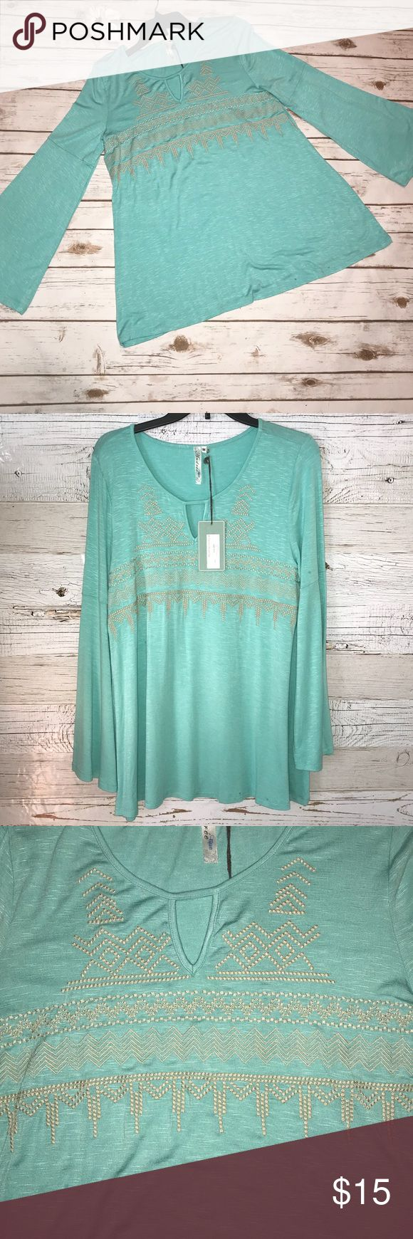 NWT Turquoise Aztec Top This Top is brand new and has never been worn. See the last pic for tags - originally $44. This Top has long sleeves that are bell sleeves. Has a keyhole neckline and cream Aztec pattern embroidery on front. andree blue Tops Blouses
