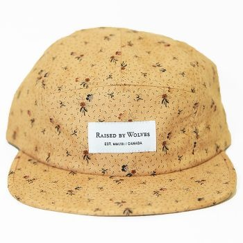 Raised By Wolves Algonquin 5 Panel Cap - Gold Civil War Floral  Label: Raised By Wolves   Format: Cap  £25.00 (£30.00 inc VAT)     Canadian born brand Raised By Wolves takes its inspiration from Skate culture, Urban clothing, and other popular trends combining them to create unique and one of a kind pieces of clothing.   •	Gold Civil War Paisley colourway  •	Cotton body  •	Raised By Wolves woven label detail  •	Web fabric adjuster at the back  •	Made in USA