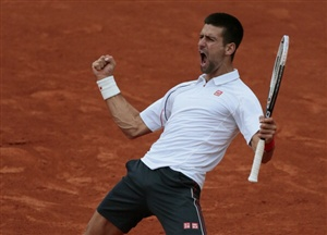 Serbia's Novak Djokovic celebrates after winning against France's Jo-Wilfried Tsonga their Men's Singles Quaterfinals tennis match of the French Open tennis tournament at the Roland Garros stadium, on June 5, 2012 in Paris