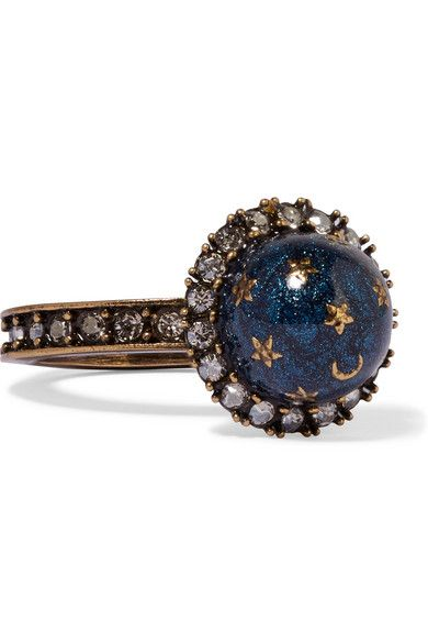 Valentino Gold-plated, Swarovski crystal and enamel ring $475 Made in Italy Valentino's gold-plated ring is burnished for an antique effect and studded with Swarovski crystals. The sparkling midnight-blue enamel dome is decorated with small stars and a crescent moon.