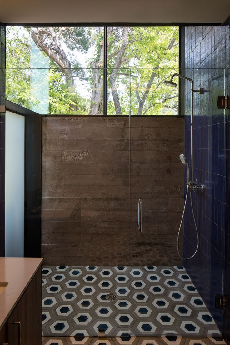 Best Photo Gallery Websites Poured in place concrete walls geometric tiles and large windows make up the Bathroom