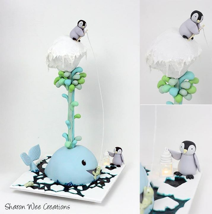 Cute penguin and whale gravity defying cake