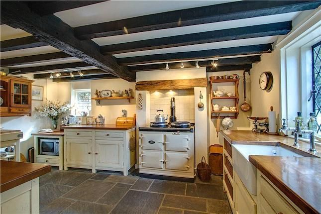 country kitchen with exposed beams and belfast sink