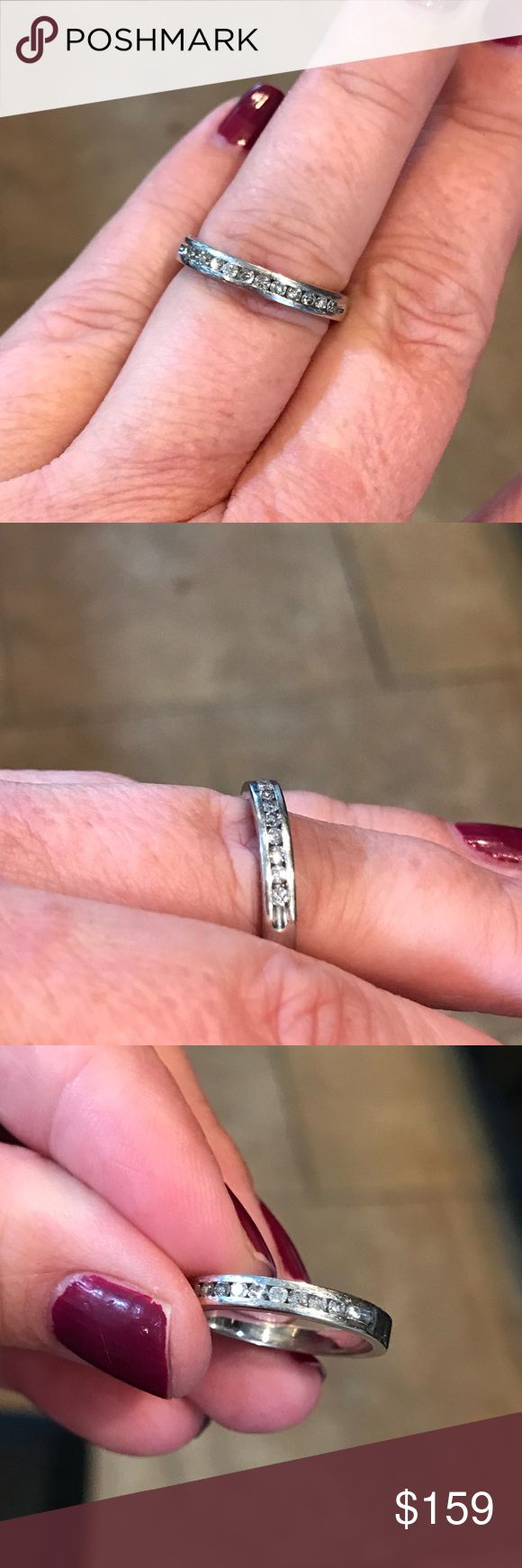 14KWG Channel set diamond band ring. 1/3 carat 14 karat white gold channel set diamond band ring. 1/3 of a carat diamond total weight. Size 6. Needs a buff. Jewelry Rings