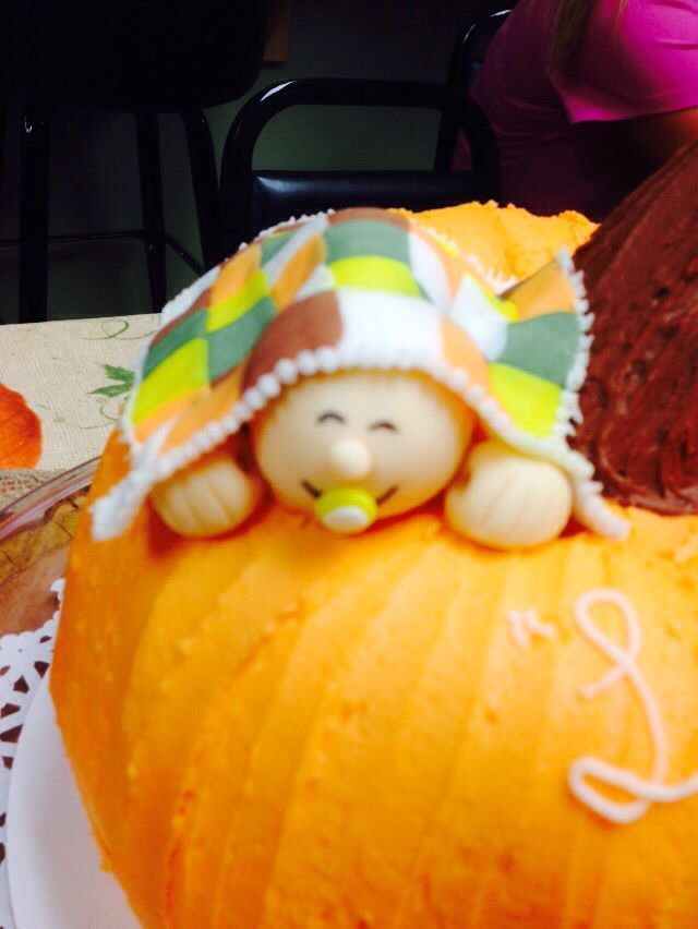 Lil baby on top of pumpkin cake