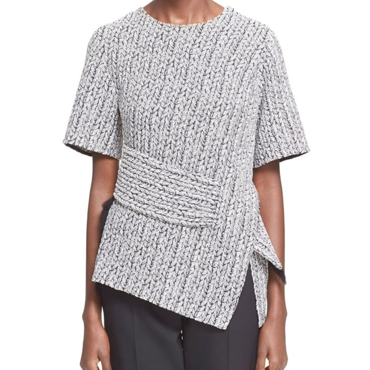 NOW ON SALE A woven jacquard finish adds subtle texture to a sleek, modern top wrapped with a fringe-trimmed belt for an extra flourish. - Rounded neck. - Short sleeves. - Split hemline. - 50% rayon,