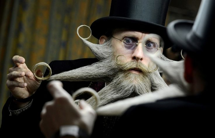 Prepping for a Beard Competition    United States' Aarne Bielefeldt dresses his beard as he prepares to attend International German Beard Championships in Bad Schussenried, southern Germany,