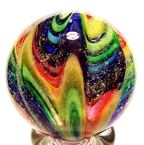 Rainbow lobed art glass marble with dichroic glass, by Eddie Seese.
