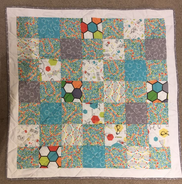 Retro science geek baby quilt / floor mat, still one of my favourite fabric collections!