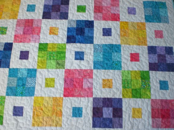 http://www.etsy.com/listing/83034676/baby-quilt-in-bright-colors  Gorgeous!