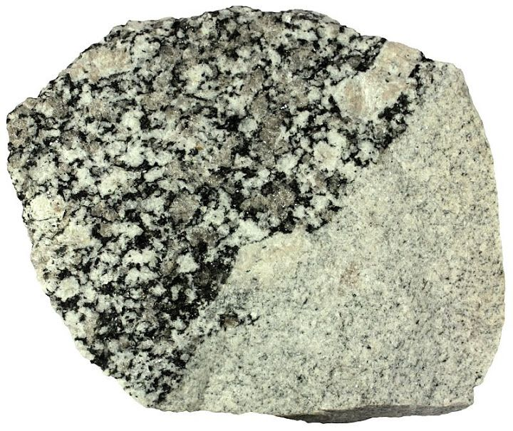 Granite  Aplite in the lower half is much finer than granite above it. Their composition seems to be the same. There are larger phenocrysts of quartz and feldspar within the granite. Width of sample 12 cm.