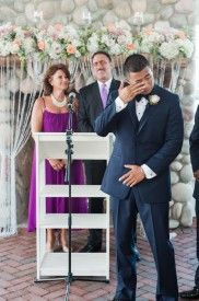 Groom crying at wedding ceremony at elegant glam wedding at Mallard Island Yacht Club